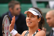 Ana Ivanovic of Serbia celebrates following victory during the Women's Singles first round match against Oceane Dodin of France on day three of the 2016 French Open at Roland Garros on May 24, 2016 in Paris, France.