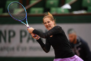 Bojana Jovanovski of Serbia plays a backhand during the Women's Singles first round match against Agnieszka Radwanska of Poland on day two of the 2016 French Open at Roland Garros on May 23, 2016 in Paris, France.