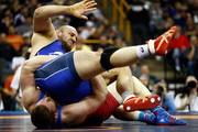 Tervel Dlagnev and Zach Rey compete during their Freestyle 125kg champiosnhip match on day 1 of the Olympic Team Wrestling Trials at Carver-Hawkeye Arena on April 9, 2016 in Iowa City, Iowa.