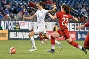 Jill Scott #8 kicks the ball past Sara Dbritz #23 of Germany during the second half of a friendly international match in the Shebelieves Cup at Nissan Stadium on March 6, 2016 in Nashville, Tennessee.