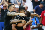 Rieko Ioane of New Zealand is embraced by teammate Sonny Bill Williams after scoring the final try to win the 2016 Sydney Sevens final match between Australia and New Zealand at Allianz Stadium on February 7, 2016 in Sydney, Australia.