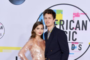 Violetta Komyshan (L) and Ansel Elgort attend the 2017 American Music Awards at Microsoft Theater on November 19, 2017 in Los Angeles, California.