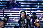 DJ David Guetta (top) and rapper Nicki Minaj perform onstage during the 2017 Billboard Music Awards at T-Mobile Arena on May 21, 2017 in Las Vegas, Nevada.
