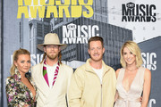 (L-R) Brittney Marie Cole, singers Brian Kelley and Tyler Hubbard of music group Florida Georgia Line, and Hayley Stommel attend the attend the 2017 CMT Music Awards at the Music City Center on June 7, 2017 in Nashville, Tennessee.