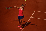 Francesca Schiavone of Italy serves during the first round match against Garbine Muguruza of Spain on day two of the 2017 French Open at Roland Garros on May 29, 2017 in Paris, France.