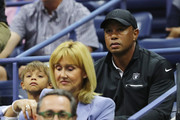 Professional golfer Tiger Woods (R) and his son Charlie Axel Woods (L) attends Day Twelve of the 2017 US Open at the USTA Billie Jean King National Tennis Center on September 8, 2017 in the Flushing neighborhood of the Queens borough of New York City.