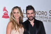Colombian singer Juanes and his wife Karen Martinez arrive for the 2017 Latin Recording Academy Person of the Year gala, honoring Spanish musician Alejandro Sanz, in Las Vegas, Nevada, on November 15, 2017. / AFP PHOTO / VALERIE MACON