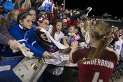 Becky Sauerbrunn #4 of the United States of America signs autographs after the match against Germany during the SheBelieves Cup at Talen Energy Stadium on March 1, 2017 in Chester, Pennsylvania. The United States defeated Germany 1-0.