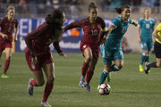 Carli Lloyd #10 of the United States of America fights for the ball along with Dzsenifer Marozsan #10 of Germany with Christen Press #23 of the United States of America running alongside them in the first half during the SheBelieves Cup at Talen Energy Stadium on March 1, 2017 in Chester, Pennsylvania.