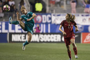 Leonie Maier #4 of Germany kicks the ball against Tobin Heath #17 of the United States of America in the second half during the SheBelieves Cup at Talen Energy Stadium on March 1, 2017 in Chester, Pennsylvania. The United States defeated Germany 1-0.