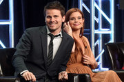 """Jason Ritter (L) and JoAnna Garcia Swisher of """"Kevin (Probably) Saves the World"""" speak onstage during the Disney/ABC Television Group portion of the 2017 Summer Television Critics Association Press Tour at The Beverly Hilton Hotel on August 6, 2017 in Beverly Hills, California."""