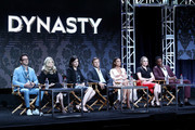 (L-R) Executive producers Josh Schwartz, Stephanie Savage, and Sallie Patrick, and actors Grant Show, Nathalie Kelley, Elizabeth Gillies, and Sam Adegoke of 'Dynasty' speak onstage during the CW portion of the 2017 Summer Television Critics Association Press Tour at The Beverly Hilton Hotel on August 2, 2017 in Beverly Hills, California.