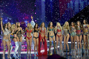 (L-R) Models Sara Sampaio, Martha Hunt, Stella Maxwell, Josephine Skriver, Elsa Hosk,  Lily Aldridge, Alessandra Ambrosio, Adriana Lima, Candice Swanepoel, Romee Strijd, Jasmine Tookes and Taylor Hill pose on the runway during the 2017 Victoria's Secret Fashion Show In Shanghai at Mercedes-Benz Arena on November 20, 2017 in Shanghai, China.