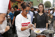 Sania Mirza of India make a noodle with Li Na of China looks on at an old city area of Wuhan during Day 2 of 2017 Wuhan Open on September 25, 2017 in Wuhan, China.