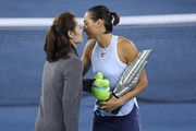Caroline Garcia greets with former tennis player Li Na at the award ceremony after winning the ladies singles final between Ashleigh Barty of Australia and Caroline Garcia of France during Day 7of 2017 Dongfeng Motor Wuhan Open at Optics Valley International Tennis Center on September 30, 2017 in Wuhan, China.