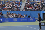 Li Na of China feeds ball to students at a tennis clinic which is part of the Wuhan Open Project at 2017 Wuhan Open on September 28, 2017 in Wuhan, China.