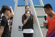 Li Na of China jokes with students after a tennis clinic which is part of the Wuhan Open Project at 2017 Wuhan Open on September 28, 2017 in Wuhan, China.