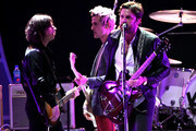 (L-R) Matthew Followill, Jared Followill and Caleb Followill of Kings of Leon perform onstage during the 2017 iHeartRadio Music Festival at T-Mobile Arena on September 23, 2017 in Las Vegas, Nevada.