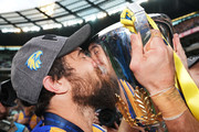 Josh Kennedy of the Eagles kisses the premiership cup after winning during the 2018 AFL Grand Final match between the Collingwood Magpies and the West Coast Eagles at Melbourne Cricket Ground on September 29, 2018 in Melbourne, Australia.