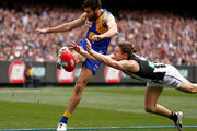 Josh Kennedy of the Eagles has his kick smothered by Tom Langdon of the Magpies during the 2018 Toyota AFL Grand Final match between the West Coast Eagles and the Collingwood Magpies at the Melbourne Cricket Ground on September 29, 2018 in Melbourne, Australia.