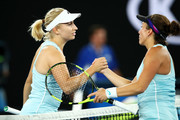Daria Gavrilova of Australia shakes hands with Francesca Schiavone of Italy after winning their round one match on day one of the 2018 Australian Open at Melbourne Park on January 15, 2018 in Melbourne, Australia.