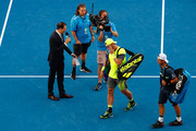 Sam Groth (L) of Australia and Lleyton Hewitt of Australia walk off the court after losing their quarter-final match against Juan Sebastian Cabal of Colombia and Robert Farah of Colombia on day 10 of the 2018 Australian Open at Melbourne Park on January 24, 2018 in Melbourne, Australia.