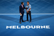 Todd Woodbridge (L) interviews Pat Cash during a special presentation to honour the 30th anniversary of Melbourne Park on day four of the 2018 Australian Open at Melbourne Park on January 18, 2018 in Melbourne, Australia.