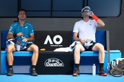 Bruno Soares of Brazil (L) and Jamie Murray of Great Britain cool down between games in their second round men's doubles match against Leander Paes of India and Purav Raja of India on day six of the 2018 Australian Open at Melbourne Park on January 20, 2018 in Melbourne, Australia.