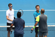 Jamie Murray of Great Britain and Bruno Soares of Brazil congratulate Leander Paes of India and Purav Raja of India after Paes and Raja won their second round men's doubles match  on day six of the 2018 Australian Open at Melbourne Park on January 20, 2018 in Melbourne, Australia.