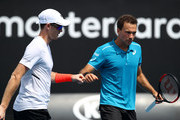 Jamie Murray of Great Britain (L) and Bruno Soares of Brazil talk tactics in their second round men's doubles match against Leander Paes of India and Purav Raja of India on day six of the 2018 Australian Open at Melbourne Park on January 20, 2018 in Melbourne, Australia.