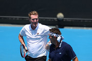 Mark Woodforde (L) of Australia and Pat Cash of Australia talk tactics in their legend's match against Fabrice Santoro of France and Mansour Bahrami of France on day eight of the 2018 Australian Open at Melbourne Park on January 22, 2018 in Melbourne, Australia.