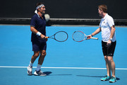 Pat Cash (L) of Australia and Mark Woodforde of Australia talk tactics in their legend's match against Fabrice Santoro of France and Mansour Bahrami of France on day eight of the 2018 Australian Open at Melbourne Park on January 22, 2018 in Melbourne, Australia.