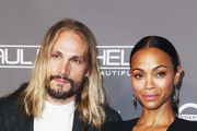 Marco Perego (L) and Zoe Saldana attend the 2018 Baby2Baby Gala Presented by Paul Mitchell at 3LABS on November 10, 2018 in Culver City, California.