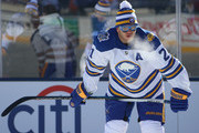Kyle Okposo #21 of the Buffalo Sabres warms up before playing in the 2018 Bridgestone NHL Winter Classic at Citi Field on January 1, 2018 in the Flushing neighborhood of the Queens borough of New York City.