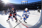 Kyle Okposo #21 of the Buffalo Sabres and Ryan McDonagh #27 of the New York Rangers vie for position in the corner during the first period of the 2018 Bridgestone NHL Winter Classic between the New York Rangers and the Buffalo Sabres at Citi Field on January 1, 2018 in the Flushing neighborhood of the Queens borough of New York City.