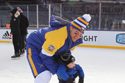 Kyle Okposo of the Buffalo Sabres skates with his son, Odin, at Practice Day for the 2018 Bridgestone NHL Winter Classic at Citi Field on December 31, 2017 in New York, New York.