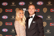Hannah Davis and Tom Mitchell of the Hawks arrive ahead of the 2018 Brownlow Medal at Crown Entertainment Complex on September 24, 2018 in Melbourne, Australia.