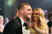 Tom Mitchell of the Hawks gets a kiss from girlfriend Hannah Davis after being announced the 2018 Brownlow Medalist at Crown Entertainment Complex on September 24, 2018 in Melbourne, Australia.