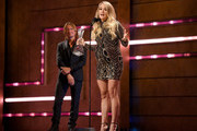 Honoree Carrie Underwood accepts an award from Keith Urban onstage during the 2018 CMT Artists of The Year at Schermerhorn Symphony Center on October 17, 2018 in Nashville, Tennessee.