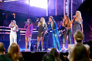 (L-R) Madison Marlow, Taylor Dye, Carrie Underwood, Hannah Mulholland, Naomi Cooke and Jennifer Wayne onstage during the 2018 CMT Artists of The Year at Schermerhorn Symphony Center on October 17, 2018 in Nashville, Tennessee.