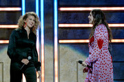Tori Kelly (L) and Hillary Scott of musical group Lady Antebellum perform onstage during the 2018 CMT Artists of The Year at Schermerhorn Symphony Center on October 17, 2018 in Nashville, Tennessee.