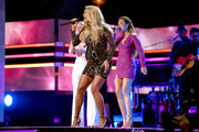 Maddie Marlow and Tae Dye of musical duo Maddie and Tae and Carrie Underwood perform onstage during the 2018 CMT Artists of The Year at Schermerhorn Symphony Center on October 17, 2018 in Nashville, Tennessee.