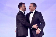 """Walt Disney Company Chairman and CEO Bob Iger presents the Courage to Care Award to Jimmy Kimmel onstage at the 2018 Children's Hospital Los Angeles """"From Paris With Love"""" Gala at LA Live on October 20, 2018 in Los Angeles, California."""