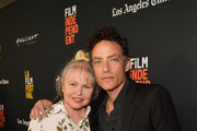 """Michelle Phillips and Jakob Dylan attend the 2018 LA Film Festival opening night premiere of """"Echo In The Canyon"""" at John Anson Ford Amphitheatre on September 20, 2018 in Hollywood, California."""