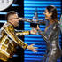 Nacho (L) accepts the Favorite Tropical Song award for 'Bailame' from Gaby Espino onstage during the 2018 Latin American Music Awards at Dolby Theatre on October 25, 2018 in Hollywood, California.