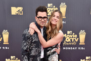 Actor-writer Daniel Levy (L) and actor Annie Murphy attend the 2018 MTV Movie And TV Awards at Barker Hangar on June 16, 2018 in Santa Monica, California.