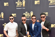 (L-R) TV personalities Vinny Guadagnino, Mike Sorrentino aka The Situation, Ronnie Ortiz-Magro, and Paul DelVecchio aka DJ Pauly D attend the 2018 MTV Movie And TV Awards at Barker Hangar on June 16, 2018 in Santa Monica, California.
