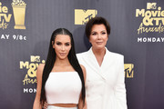 TV personalities Kim Kardashian (L) and Kris Jenner attend the 2018 MTV Movie And TV Awards at Barker Hangar on June 16, 2018 in Santa Monica, California.