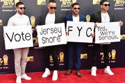 (L-R) TV personalities Vinny Guadagnino,  Paul DelVecchio aka DJ Pauly D, Mike Sorrentino aka The Situation, and Ronnie Ortiz-Magro attend the 2018 MTV Movie And TV Awards at Barker Hangar on June 16, 2018 in Santa Monica, California.