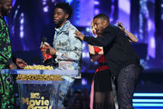 Recording artist Lady Gaga (2nd from R) presents the Best Movie award (Presented by Toyota) for 'Black Panther' to actors  (from L) Winston Duke, Chadwick Boseman, and Michael B. Jordan onstage during the 2018 MTV Movie And TV Awards at Barker Hangar on June 16, 2018 in Santa Monica, California.